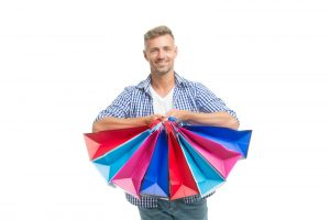 Man with a bunch of shopping bags